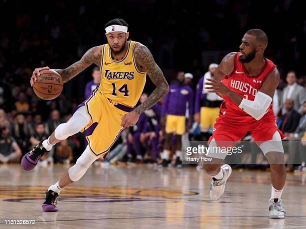 Brandon Ingram of the Los Angeles Lakers drives to the basket on Chris Paul of the Houston Rockets during a 111106 Laker win at Staples Center on...