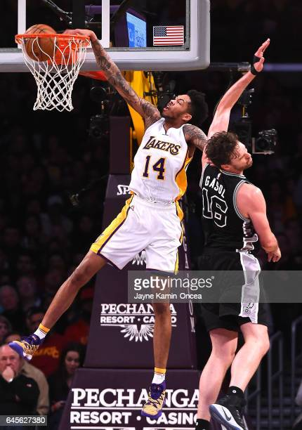 Brandon Ingram of the Los Angeles Lakers dunks over Pau Gasol of the San Antonio Spurs in the second half of the game against the San Antonio Spurs...