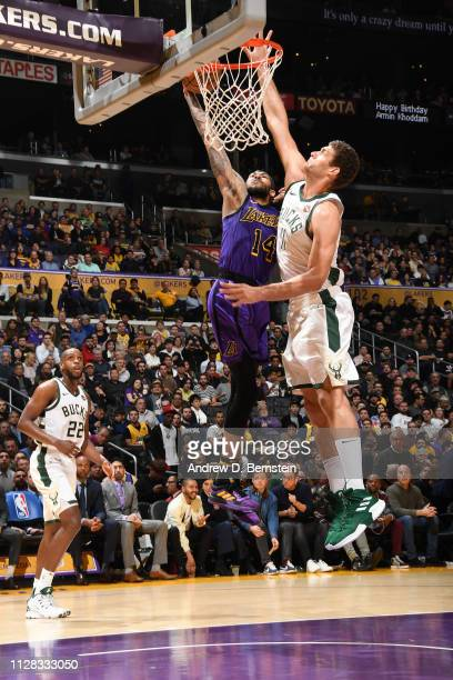 Brandon Ingram of the Los Angeles Lakers dunks the ball against Brook Lopez of the Milwaukee Bucks on March 1 2019 at STAPLES Center in Los Angeles,...