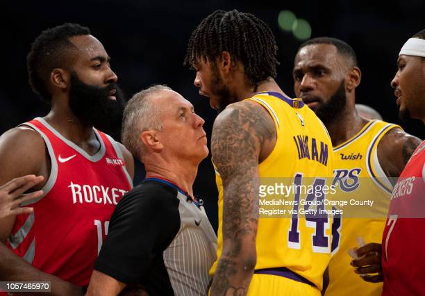 Brandon Ingram of the Los Angeles Lakers gets in the face of referee Jason Phillips before a fight breaks out during the Lakers' home opener against...