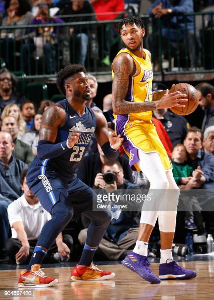 Brandon Ingram of the Los Angeles Lakers handles the ball against Wesley Matthews of the Dallas Mavericks on January 13 2018 at the American Airlines...