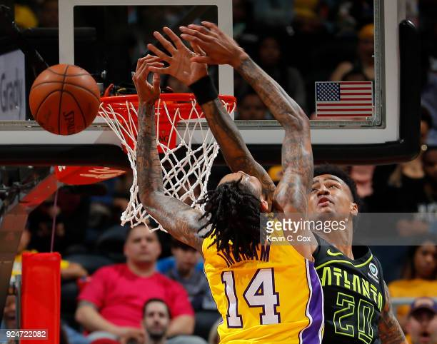 Brandon Ingram of the Los Angeles Lakers has his dunk blocked by John Collins of the Atlanta Hawks at Philips Arena on February 26 2018 in Atlanta...