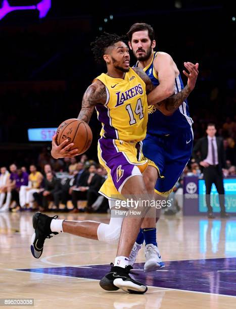 Brandon Ingram of the Los Angeles Lakers is fouled by Omri Casspi of the Golden State Warriors during a 116114 Warrior overtime win at Staples Center...