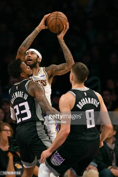 Brandon Ingram of the Los Angeles Lakers is guarded by Ben McLemore and Bogdan Bogdanovic of the Sacramento Kings in the first half at Staples Center...