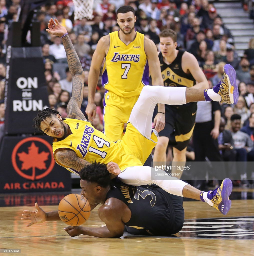 Brandon Ingram #14 of the Los Angeles Lakers is upended by OG Anunoby #3 of the Toronto Raptors in an NBA game at the Air Canada Centre on January 28, 2018 in Toronto, Ontario, Canada. The Raptors defeated the Lakers 123-111.