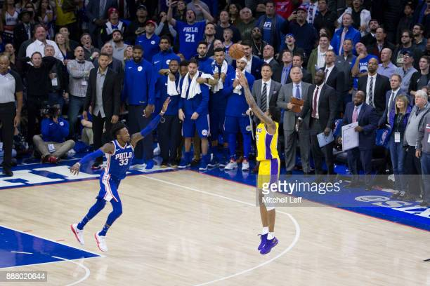 Brandon Ingram of the Los Angeles Lakers makes the game winning three point basket in the final seconds of the game against Robert Covington of the...