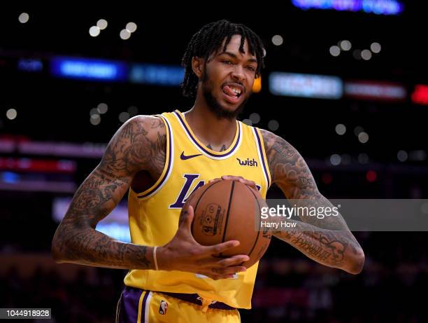 Brandon Ingram of the Los Angeles Lakers reacts as he inbounds the ball during a preseason against the Denver Nuggets game at Staples Center on...