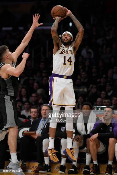 Brandon Ingram of the Los Angeles Lakers shoots a jump shot over Bogdan Bogdanovic of the Sacramento Kings at Staples Center on December 30 2018 in...