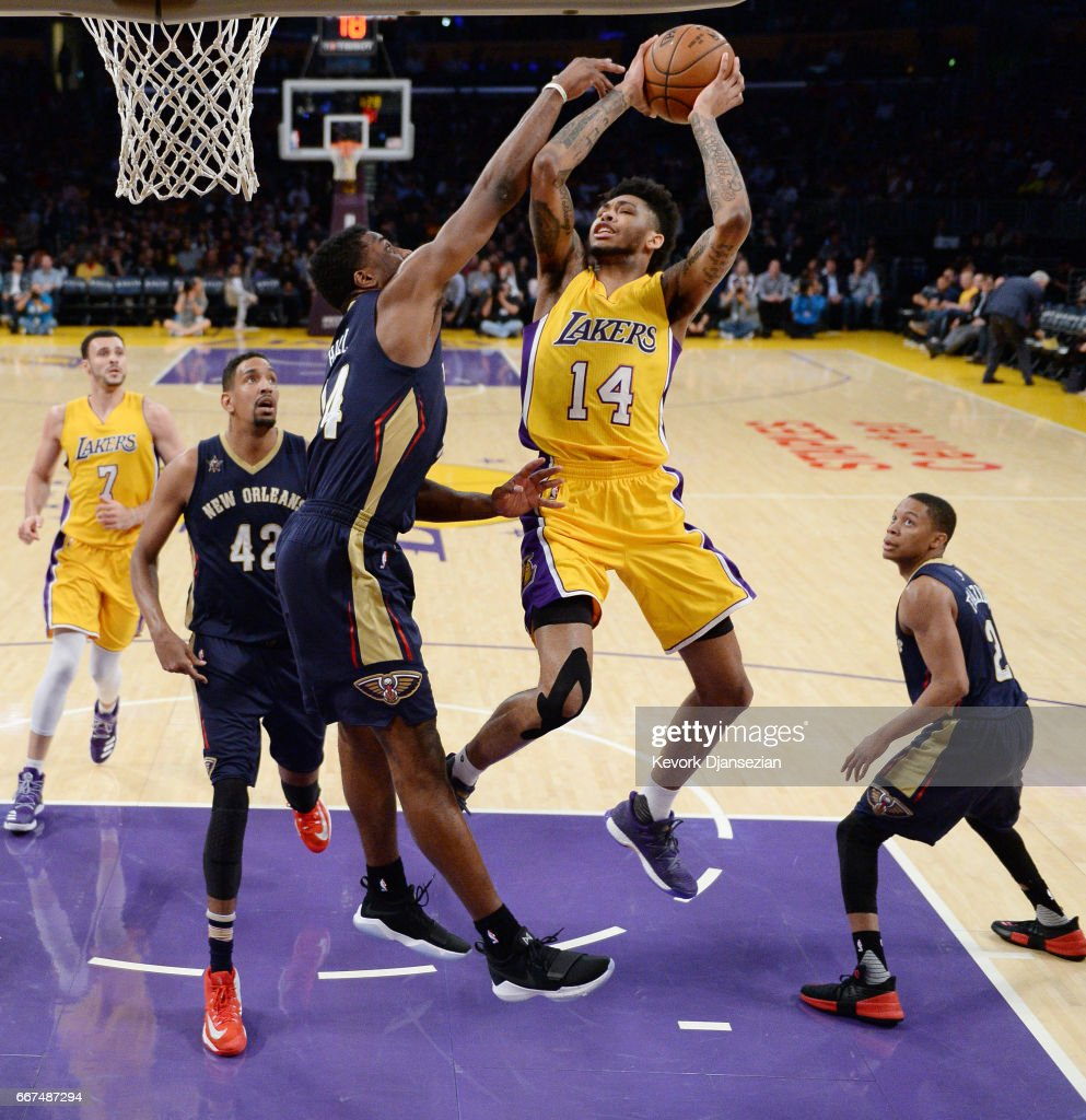 Brandon Ingram #14 of the Los Angeles Lakers shoots a layup over Solomon Hill #44 of the New Orleans Pelicans during the first half of the basketball game at Staples Center April 11, 2017, in Los Angeles, California.