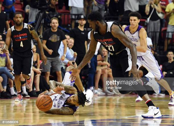 Brandon Ingram of the Los Angeles Lakers steals the ball from Jamil Wilson of the Los Angeles Clippers near the end of regulation during the 2017...