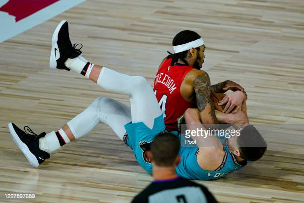 Brandon Ingram of the New Orleans Pelicans and Grayson Allen of the Memphis Grizzlies competes for a loose ball during the second half of an NBA...