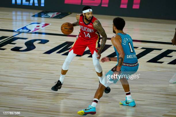 Brandon Ingram of the New Orleans Pelicans controls the ball against Kyle Anderson of the Memphis Grizzlies during the second half of an NBA...