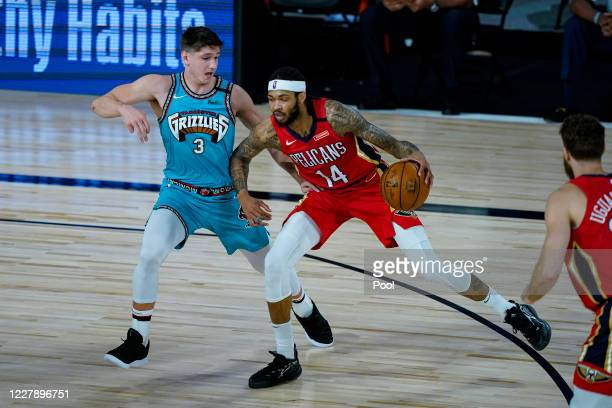Brandon Ingram of the New Orleans Pelicans drives on Grayson Allen of the Memphis Grizzlies during the first half of an NBA basketball game at HP...