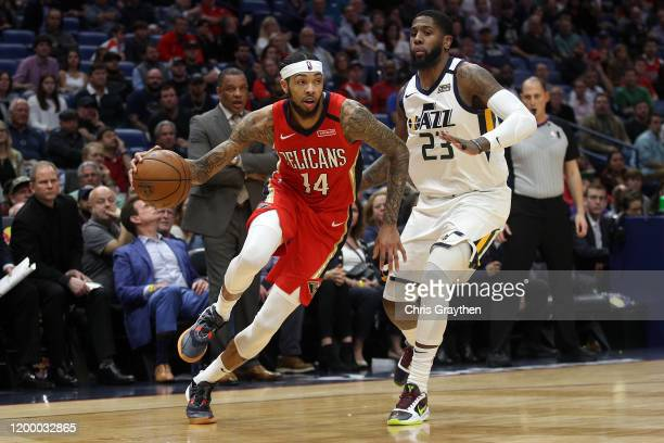 Brandon Ingram of the New Orleans Pelicans drives the ball around Royce O'Neale of the Utah Jazz at Smoothie King Center on January 16 2020 in New...