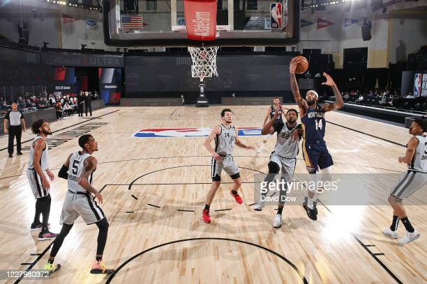 Brandon Ingram of the New Orleans Pelicans drives to the basket against the San Antonio Spurson August 9 2020 in Orlando Florida at The Field House...