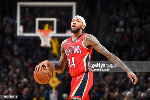 Brandon Ingram of the New Orleans Pelicans handles the ball during the game against the Denver Nuggets on December 25, 2019 at the Pepsi Center in...