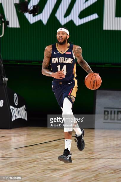 Brandon Ingram of the New Orleans Pelicans handles the ball during the game against the Milwaukee Bucks during a scrimmage on July 27, 2020 at The...