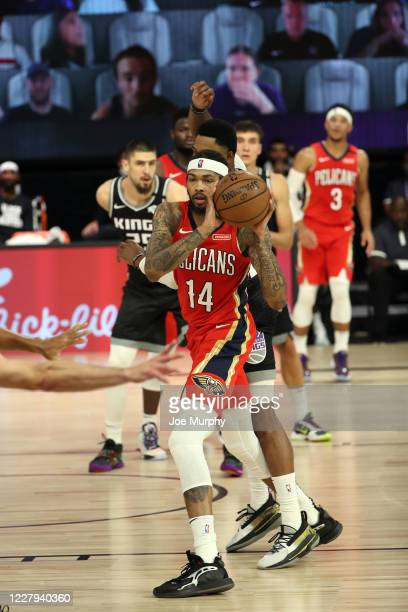 Brandon Ingram of the New Orleans Pelicans handles the ball during the game against the Sacramento Kings on August 6 2020 at The HP Field House at...