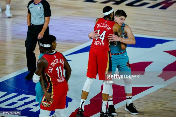 Brandon Ingram of the New Orleans Pelicans hugs Grayson Allen of the Memphis Grizzlies after the Pelicans' 10999 win in an NBA basketball game at HP...