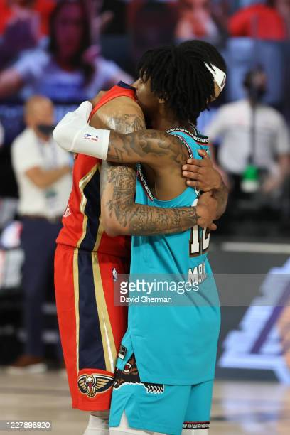 Brandon Ingram of the New Orleans Pelicans hugs Ja Morant of the Memphis Grizzlies after the game on August 3 2020 at HP Field House at ESPN Wide...