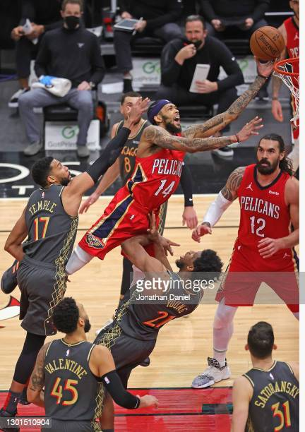 Brandon Ingram of the New Orleans Pelicans is called for an offensive foul against Thaddeus Young of the Chicago Bulls as he drives to the basket...