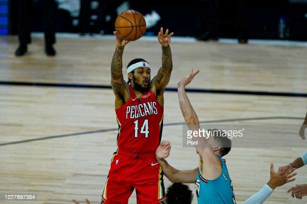 Brandon Ingram of the New Orleans Pelicans makes a pass over Grayson Allen of the Memphis Grizzlies during the second half of an NBA basketball game...