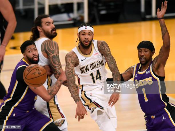 Brandon Ingram of the New Orleans Pelicans passes in front of Anthony Davis and Kentavious Caldwell-Pope of the Los Angeles Lakers during the first...