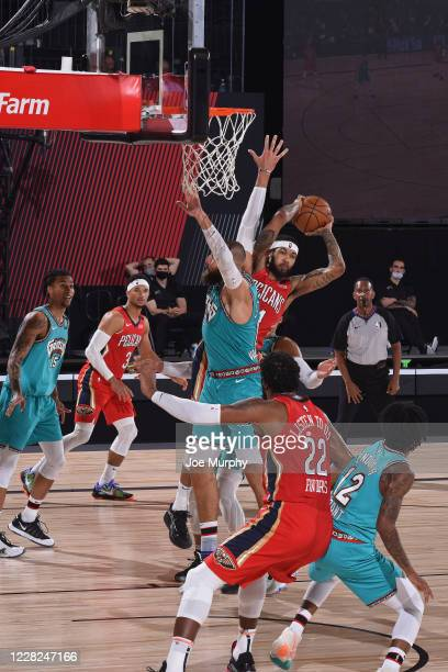 Brandon Ingram of the New Orleans Pelicans passes the ball against the Memphis Grizzlies on August 3 2020 at The Visa Athletic Center at ESPN Wide...