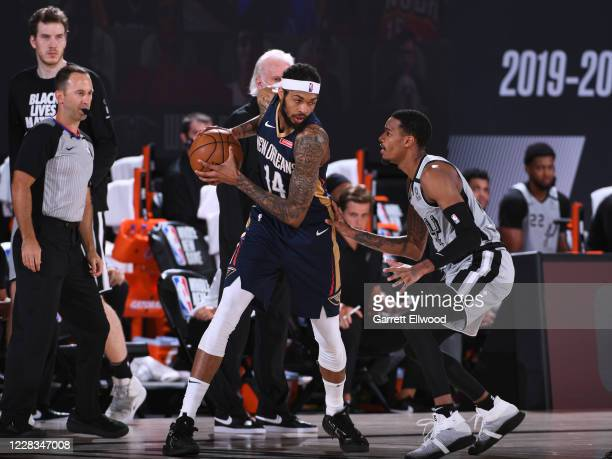 Brandon Ingram of the New Orleans Pelicans posts up on Lonnie Walker IV of the San Antonio Spurs on August 9 2020 at The Field House at ESPN Wide...