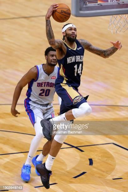 Brandon Ingram of the New Orleans Pelicans scores as Josh Jackson of the Detroit Pistons defends during the second half at the Smoothie King Center...