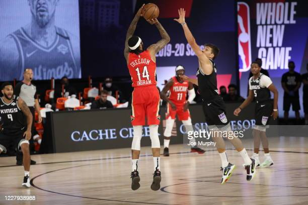 Brandon Ingram of the New Orleans Pelicans shoots a three point basket during the game against the Sacramento Kings on August 6 2020 at The HP Field...
