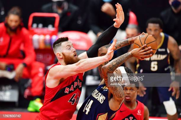 Brandon Ingram of the New Orleans Pelicans shoots against Aron Baynes of the Toronto Raptors during the second half at Amalie Arena on December 23,...