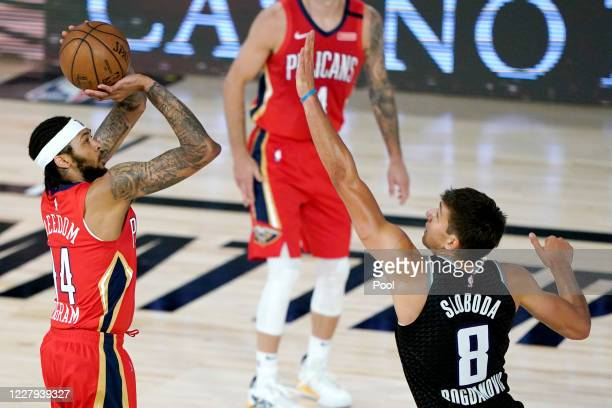 Brandon Ingram of the New Orleans Pelicans shoots against Bogdan Bogdanovic of the Sacramento Kings during the first half of an NBA basketball game...