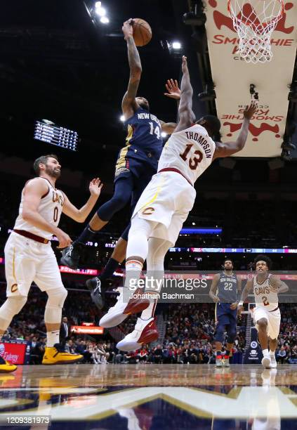 Brandon Ingram of the New Orleans Pelicans shoots against Tristan Thompson of the Cleveland Cavaliers and Kevin Love during the first half at the...