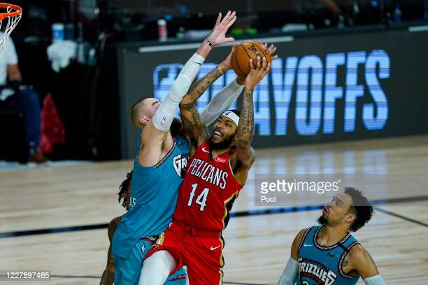Brandon Ingram of the New Orleans Pelicans shoots over Jonas Valanciunas of the Memphis Grizzlies during the first half of an NBA basketball game at...