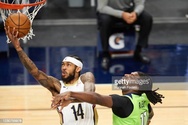Brandon Ingram of the New Orleans Pelicans shoots the ball against Naz Reid of the Minnesota Timberwolves during the first quarter of the game at...