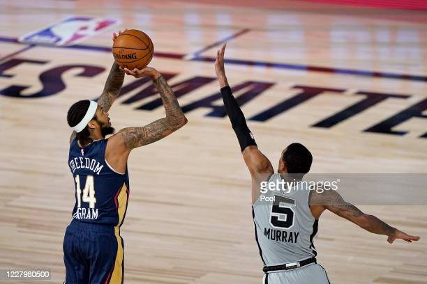 Brandon Ingram of the New Orleans Pelicans takes a shot over Dejounte Murray of the San Antonio Spurs during the second half at HP Field House at...