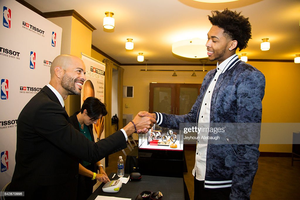 Brandon Ingram tries on a Tissot watch on June 22, 2016 in New York City.