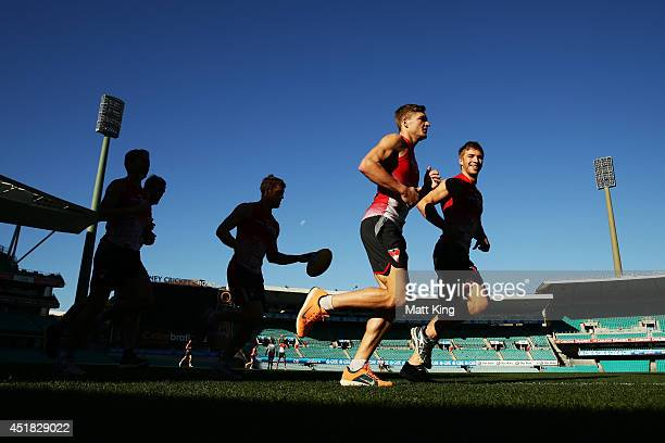 Brandon Jack and Kieren Jack run laps during a Sydney Swans AFL training session at Sydney Cricket Ground on July 8 2014 in Sydney Australia