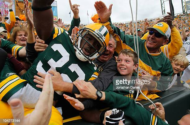 Brandon Jackson of the Green Bay Packers celebrates a touchdown with a 'Lambeau Leap' into the stands against of the Buffalo Bills at Lambeau Field...