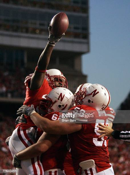 Brandon Jackson of the Nebraska Cornhuskers celebrates his touchdown catch with Andy Christensen and Brett Byford against the Colorado Buffaloes in...