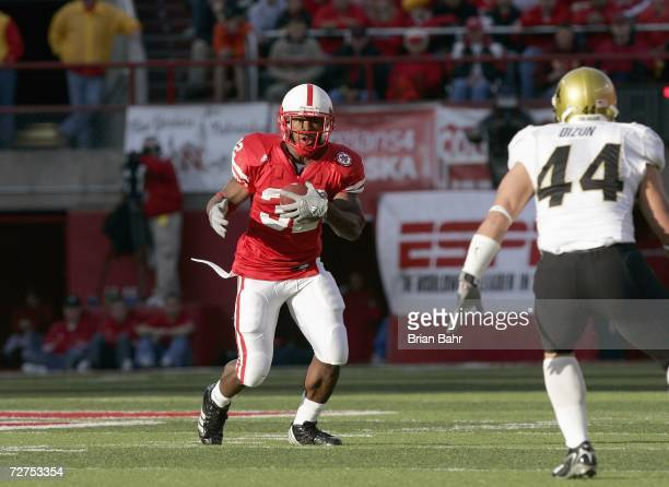 Brandon Jackson of the Nebraska Cornhuskers runs against inside linebacker Jordon Dizon of the Colorado Buffaloes on November 24 2006 at Memorial...
