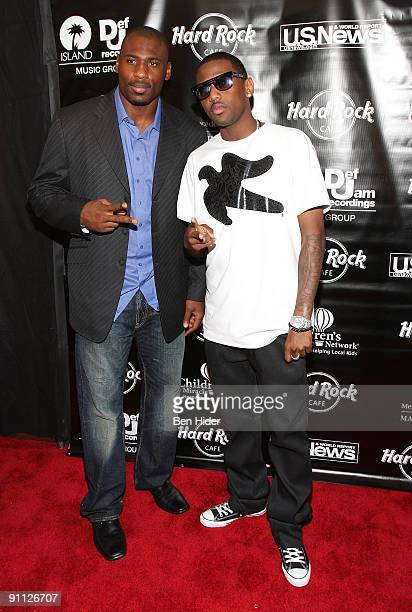 Brandon Jacobs and Fabolous attend the 3rd annual Tiki Rocks The Square for the Children's Miracle Network at the Hard Rock Cafe Times Square on...