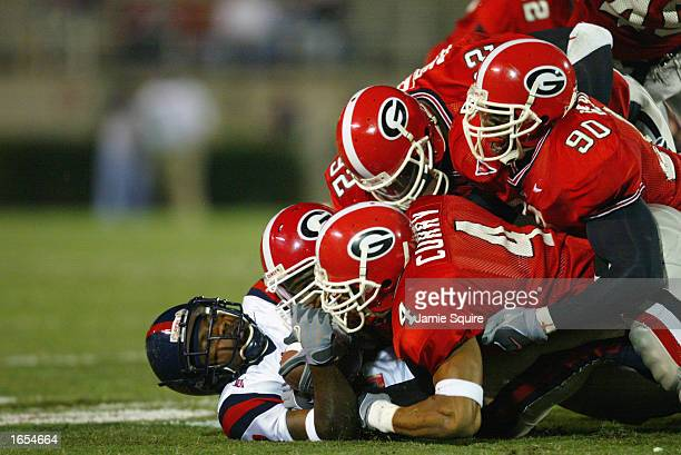 Brandon Jacobs of Mississippi is brought down by the Georgia defense during the SEC game on November 9, 2002 at Sanford Stadium in Athens, Georgia....