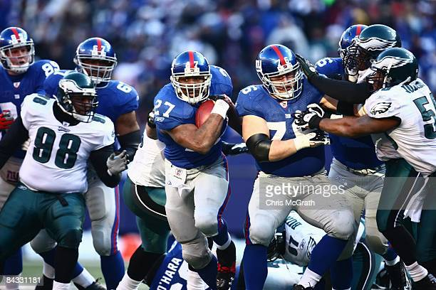 Brandon Jacobs of the New York Giants runs the ball against the Philadelphia Eagles during the NFC Divisional Playoff Game on January 11, 2009 at...