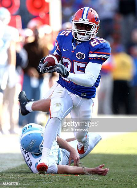 Brandon James of the Florida Gators breaks a tackle during the game against the Citadel Bulldogs at Ben Hill Griffin Stadium on November 22 2008 in...