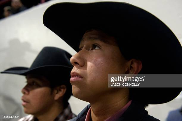 Brandon James of the Navajo Nation waits to compete in the bull riding completion during the MLK Jr African American Heritage Rodeo at the National...