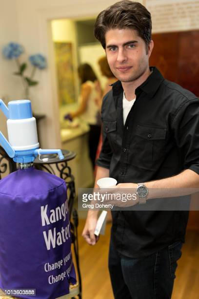 Brandon Jay drinks Kangen Water as he attends the TAP The Artists Project Giveback Day on August 8 2018 in Los Angeles California