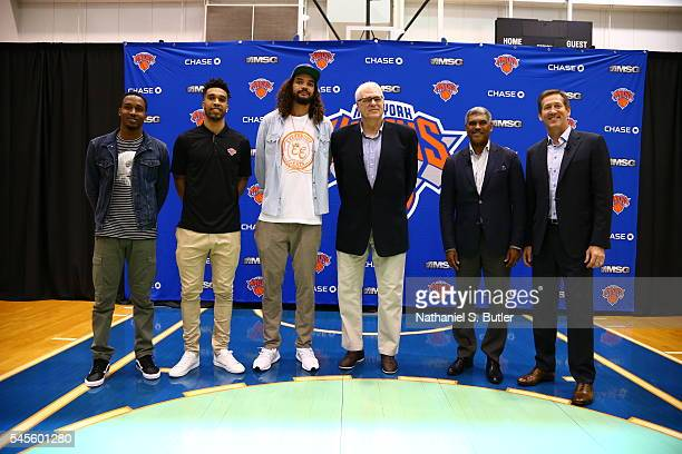 Brandon Jennings Courtney Lee and Joakim Noah poses with New York Knicks President Phil Jackson General Manager Steve Mills and Head Coach Jeff...