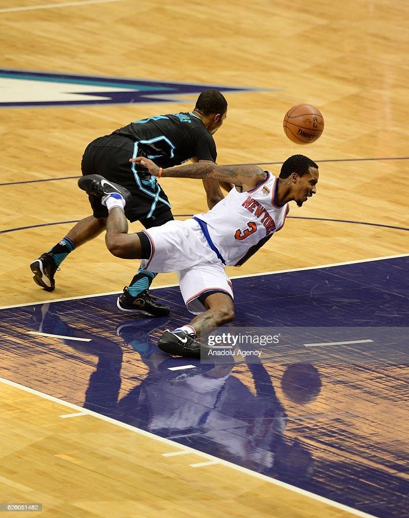 Brandon Jennings (R) of New York Knicks falls during the NBA match between New York Knicks vs Charlotte Hornets at the Spectrum arena in Charlotte, NC, USA on November 26, 2016.